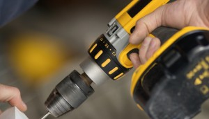 Carpenter using electric portable power drill